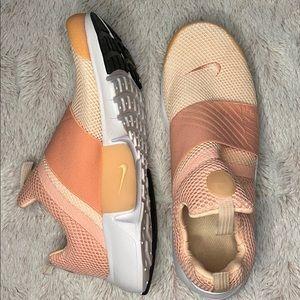 cream and pink Nike presto